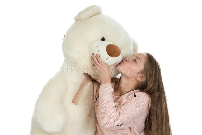 Bild av den lyckliga tonårs- flickan med nallebjörnen fotografering för bildbyråer