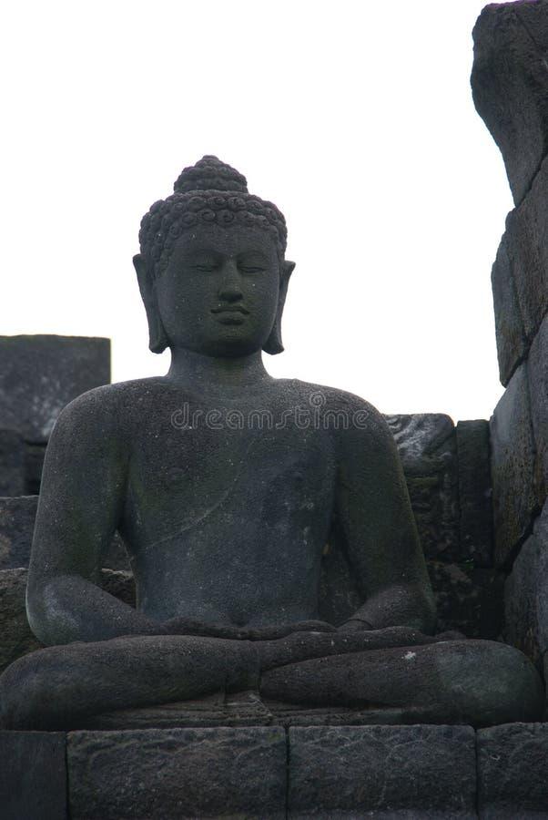 Bild av den sittande Buddha i den Borobudur templet, Jogjakarta, Indonesien arkivfoto