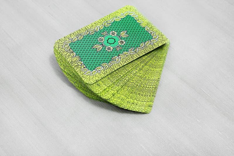 Bild av det spela kortet för tillbaka grön textur royaltyfri bild