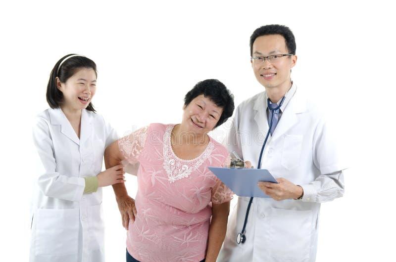 Bild av en doktor och hans sjuksköterska arkivfoto