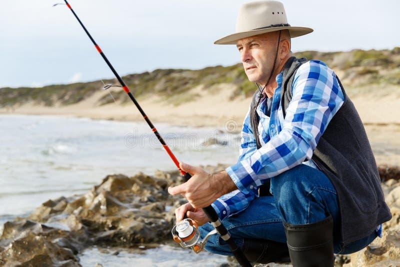 Bild av fiskaren arkivfoto