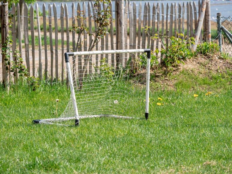 Bild av målet för barnleksakfotboll i trädgården royaltyfri foto