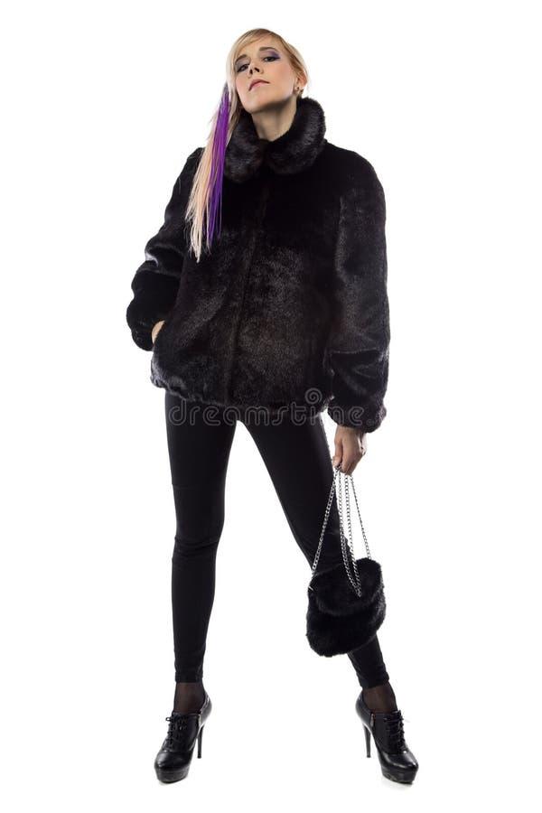 Bild der arroganten Frau mit Handtasche lizenzfreie stockfotos