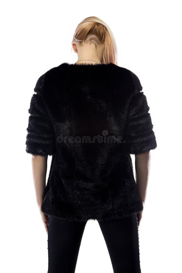 Bild der Blondine, Kopf unten von der Rückseite lizenzfreie stockfotografie