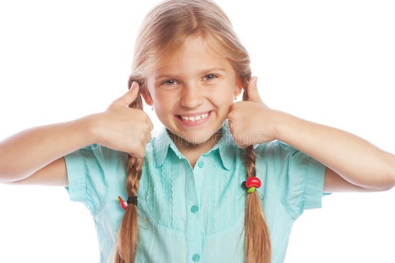 Bild der glücklichen Stellung des kleinen Mädchens Kinderlokalisiert über weißem Ba lizenzfreies stockbild