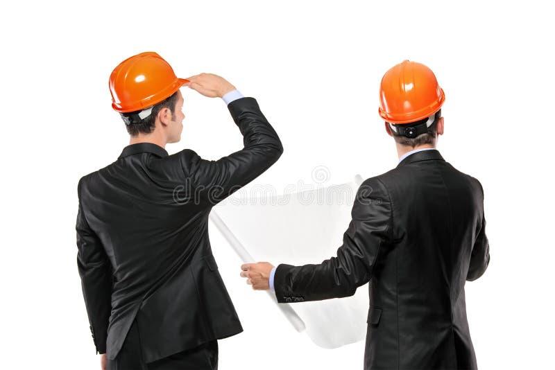 Bild der Vorarbeiter, die zusammen bei der Sitzung zusammenwirken stockbilder