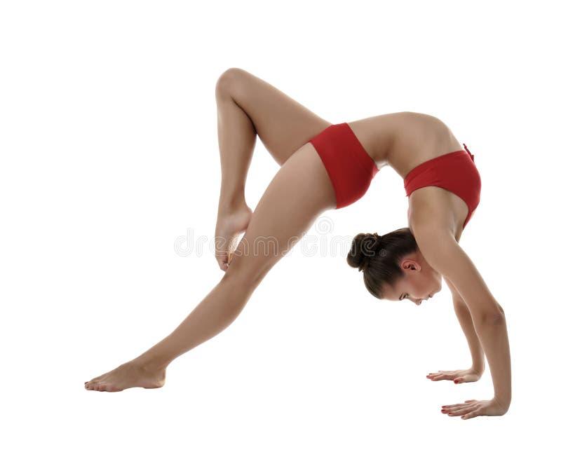 Bild des flexiblen Mädchens gymnastische Haltung tuend stockbilder