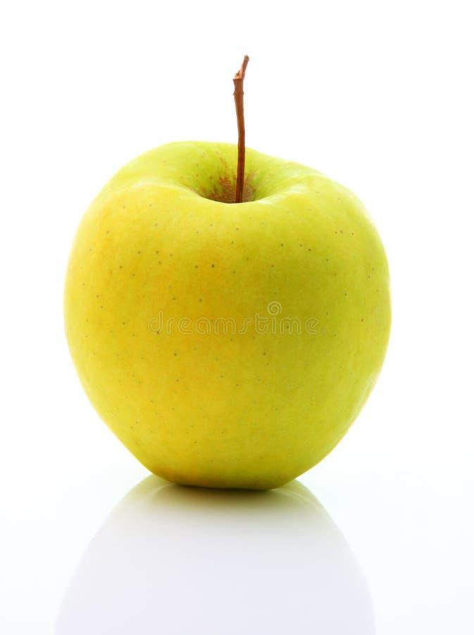Bild des gelben Apfels getrennt über Weiß stockbild