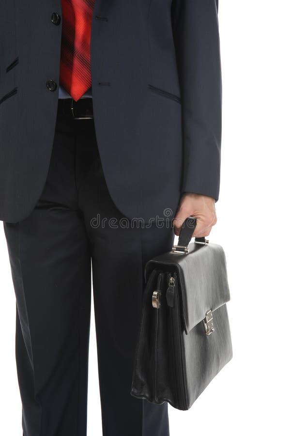 Bild eines Geschäftsmannes, der einen Aktenkoffer anhält stockfoto