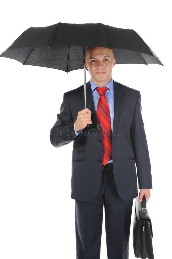 Bild eines Geschäftsmannes mit Regenschirm lizenzfreies stockbild