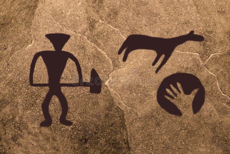 Bild som dras av en forntida man på väggen arkivfoto