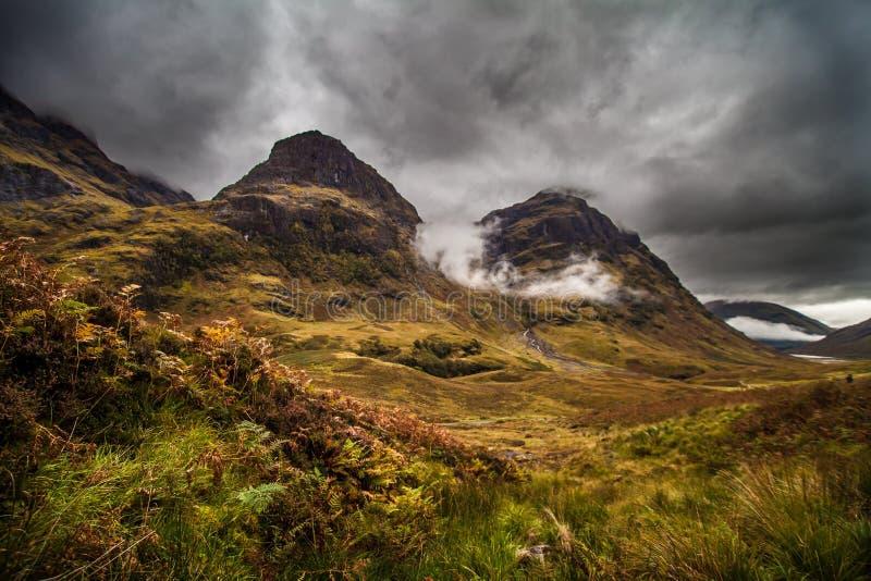 Bildande för tre systrar, Glencoe, Skottland royaltyfri bild