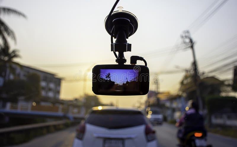 Bildautos und Sun-Morgen auf Kamera im Auto lizenzfreie stockfotos