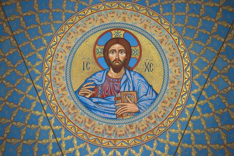 Bilden av Jesus Christ på insidan av kupolen i St Nicholas den sjö- domkyrkan Kronstadt arkivfoton
