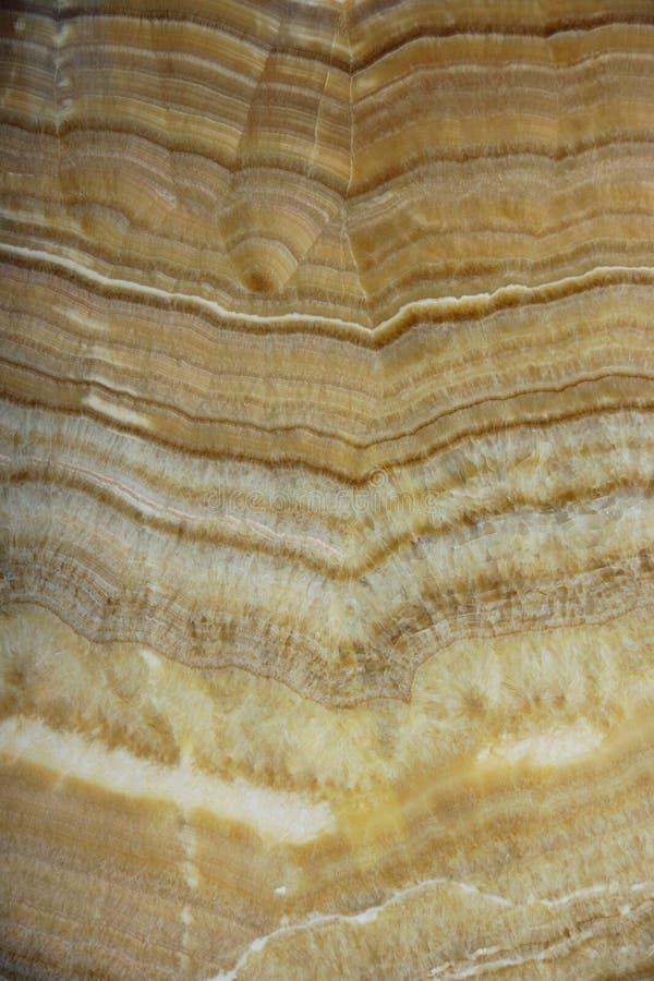 Bilden av naturen på tjock skiva av ett naturligt stenar onyx som är vertikal royaltyfri foto