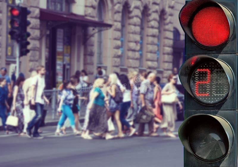 Bilder av röda trafikljus och folk royaltyfri bild