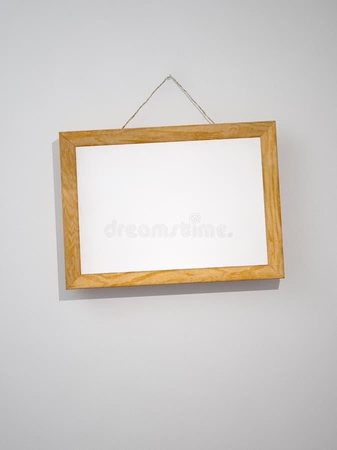 Bilderrahmen auf der Wand lizenzfreie abbildung