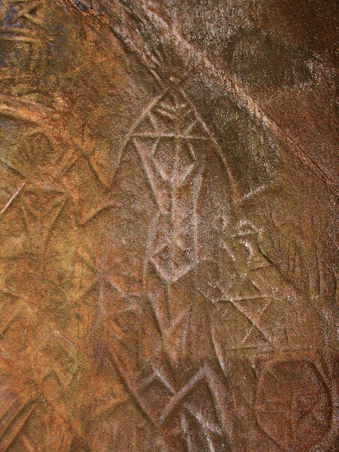 Bildmässiga handstilar av mannen för stenålder, Edakkal grottor arkivbilder