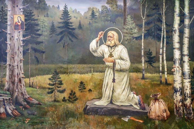 Bildsammansättning - bönen av St-serafen av Sarov arkivbilder