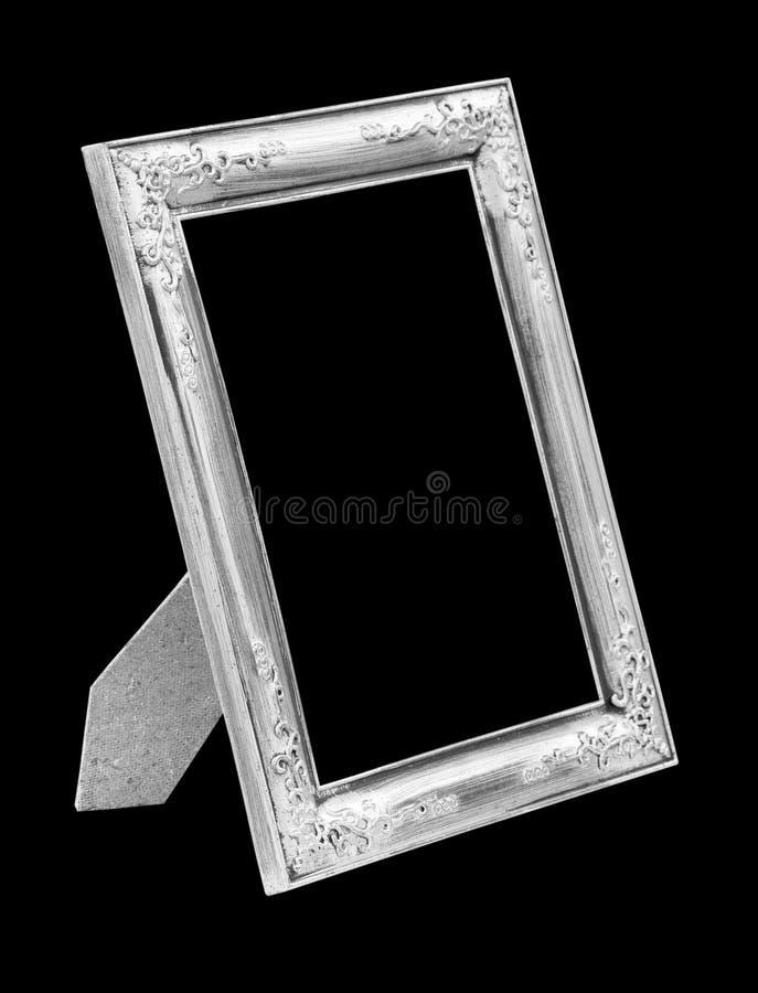 Bildsilverram som isoleras på svart arkivfoton