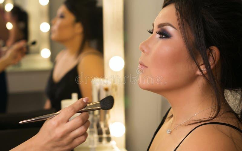 Bildskapelseprocess makeup royaltyfria bilder