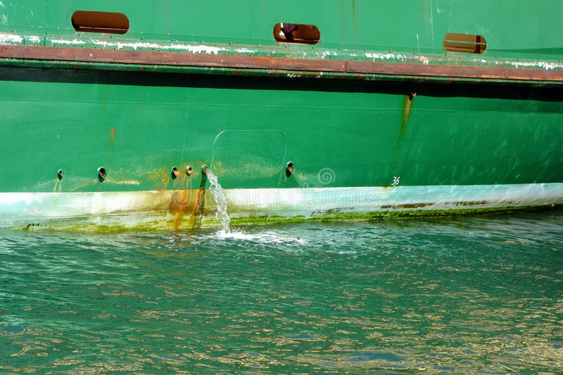 Bilge Water Pumped From Ship stock foto