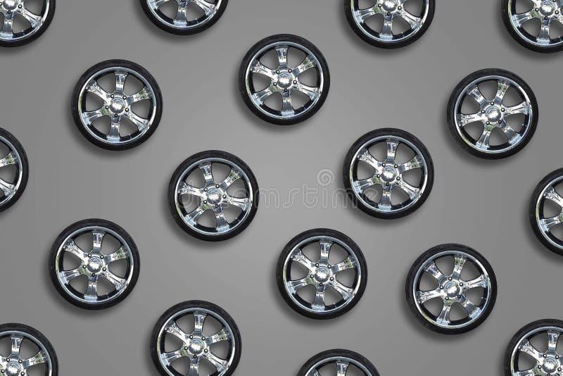 Bilhjul på grå bakgrund Transport Reservdelar Försäljning av automatiska hjul royaltyfri foto