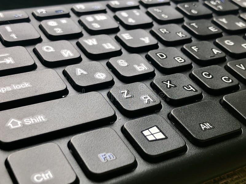 QWERTY keyboard black. Bilingual QWERTY English and Russian alphabet black keyboard royalty free stock image