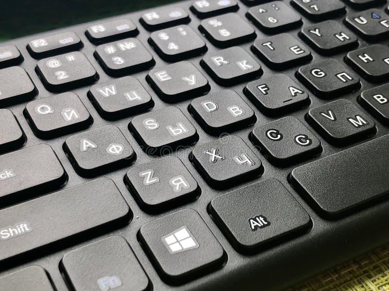 QWERTY keyboard black. Bilingual QWERTY English and Russian alphabet black keyboard stock photography