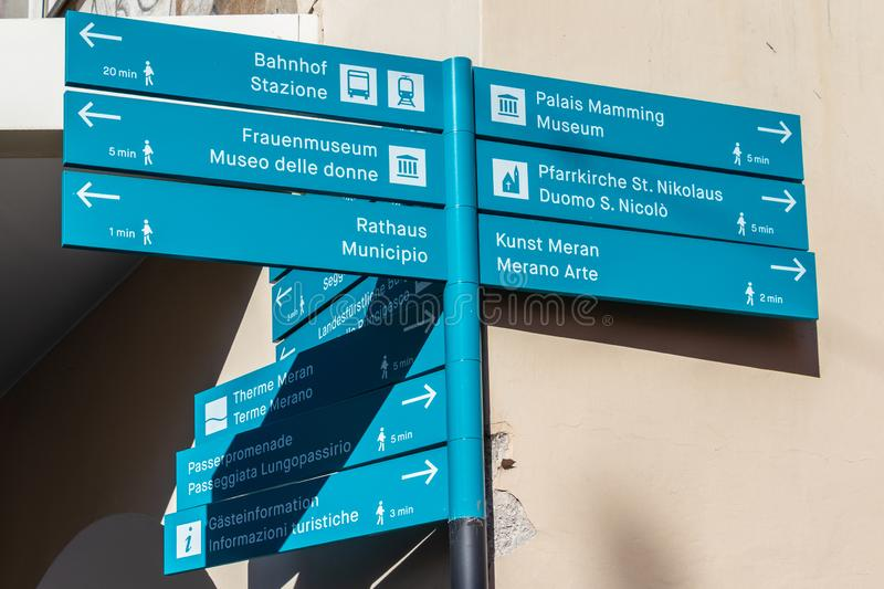Bilingual Signpost in the main district of Meran guide tourists located in Laubengasse. Merano. Province Bolzano, South Tyrol,. The spa town of Merano lies in stock image