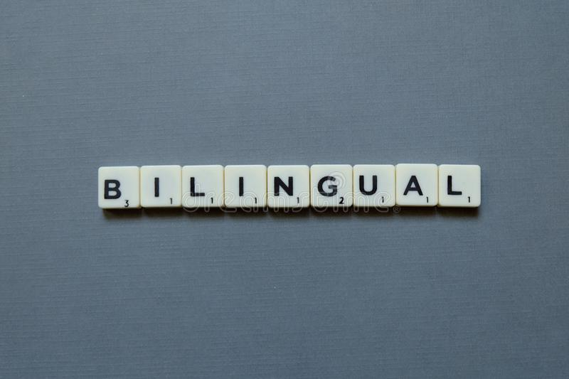 Bilingual words on grey background royalty free stock photos