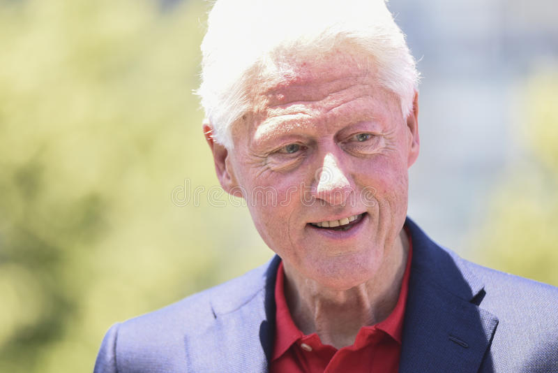 Bill Clinton. Former president Bill Clinton in hard sunlight on Roosevelt Island during wife, Hillary's, announcement of her candidacy for the Democratic royalty free stock photos