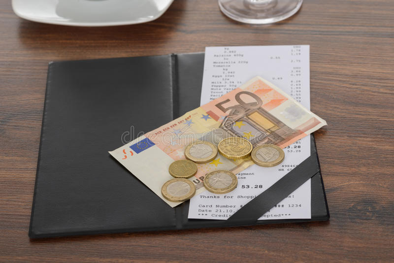 Bill with euro note on table stock photos