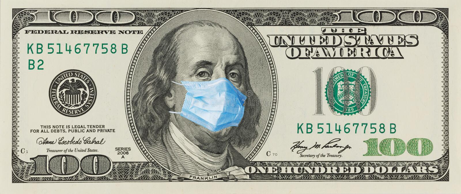 A 100 bill with a medical mask from Benjamin Franklin from the COVID-19 Coronavirus in the United States. A 100-dollar bill with a face mask by Benjamin Franklin royalty free stock image