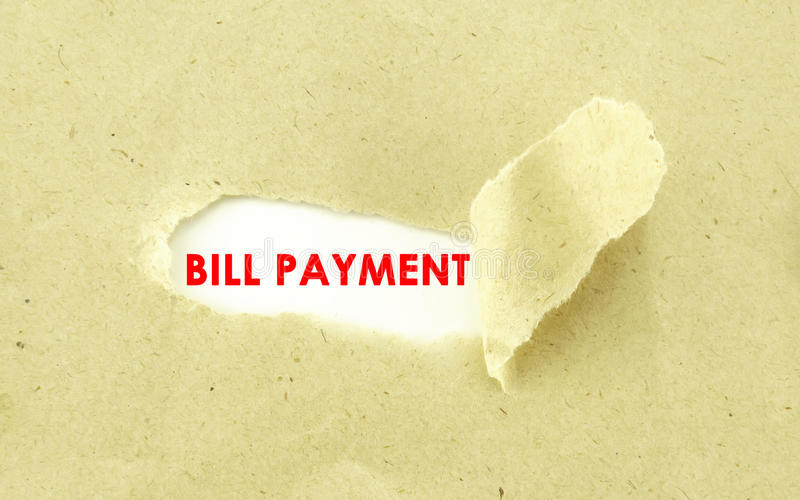 BILL PAYMENT. Text BILL PAYMENT appearing behind torn light brown envelop stock photos