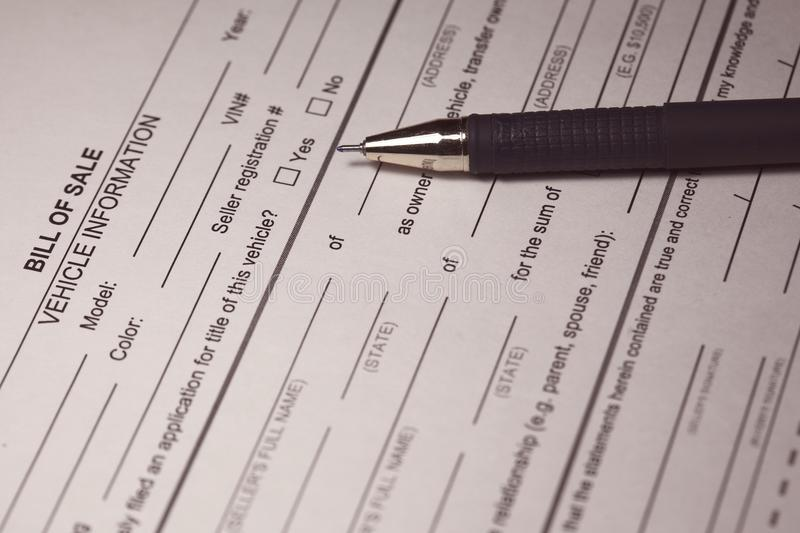 Bill of Sale Form and pen stock images