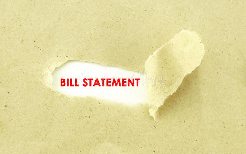 Bill Statement. Text BILL STATEMENT appearing behind torn light brown envelop stock photo
