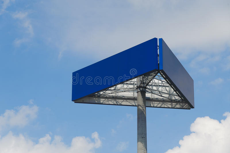 Billboard. Blue billboard and cloudy sky stock photography