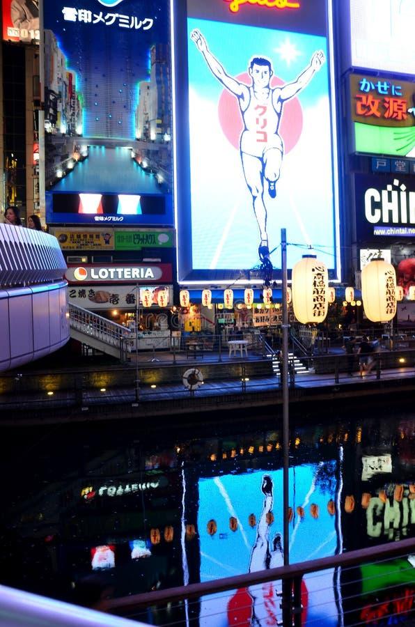 Billboard advertising and reflection in Dotonbori river at Doton. Bori on July 7, 2015 in Osaka, Japan royalty free stock photos