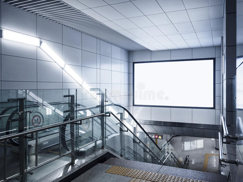 Billboard Banner signage mock up display in subway with escalator royalty free stock photos