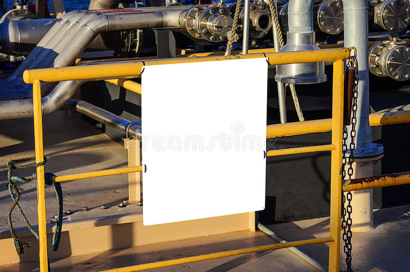 Billboard blank for advertising poster. At yellow tube on industrial background royalty free stock photo