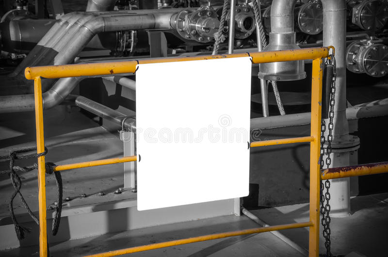 Billboard blank for advertising poster. At yellow tube on industrial background. Black and whie tone stock images