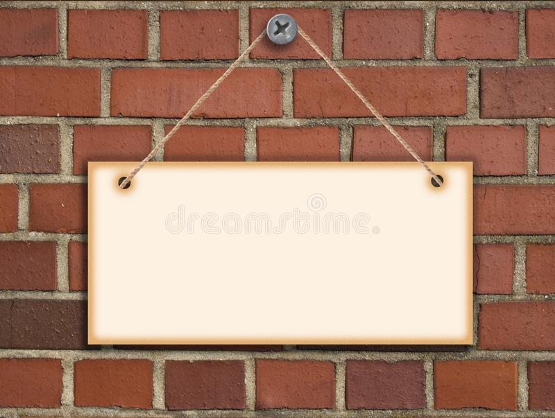 Billboard on brick wall built with red brick. information for blank paper hanging on the wall.  stock photo