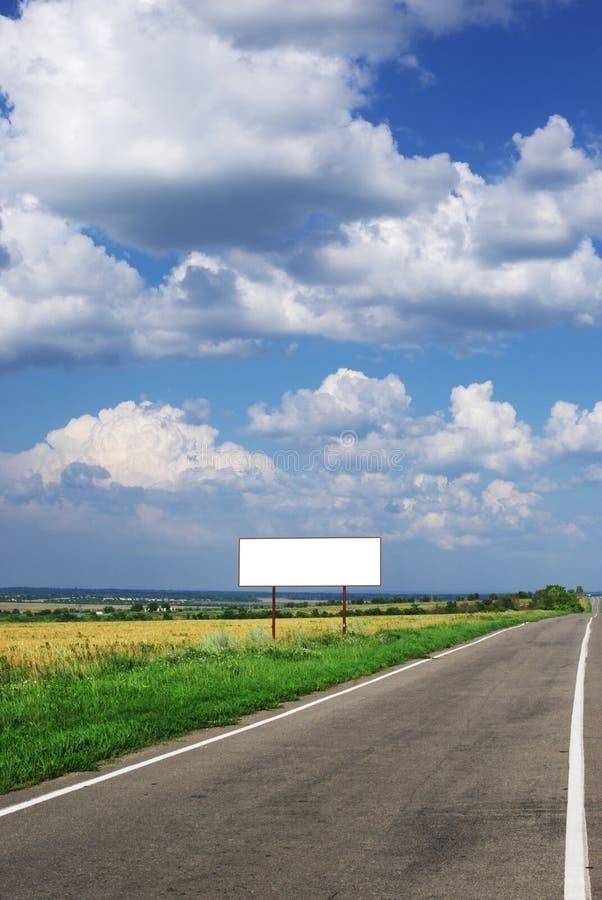 Billboard and long road