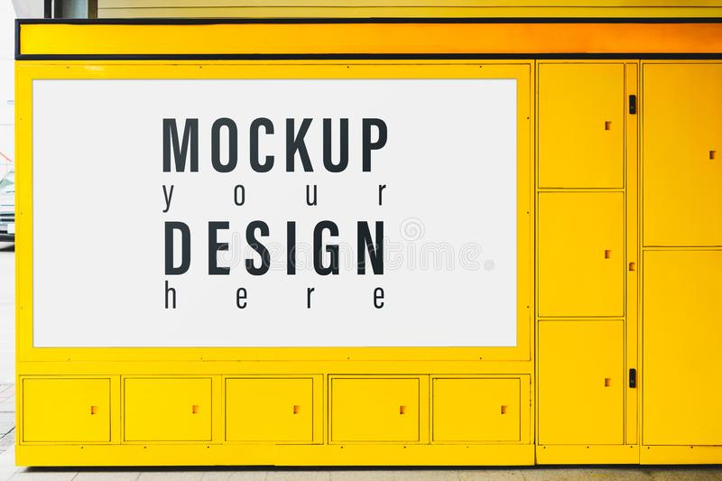 Billboard mockup for advertising on the yellow lockbox. Blank mock up of street poster billboard for your text message or. Promotional content, advertise stock photography