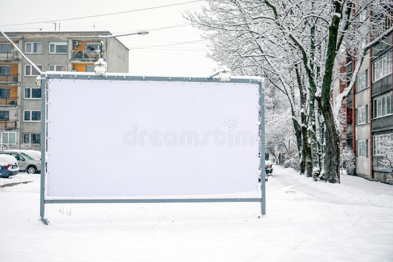 Billboard mockup poster stand in the street. Winter, snow and cold stock photo