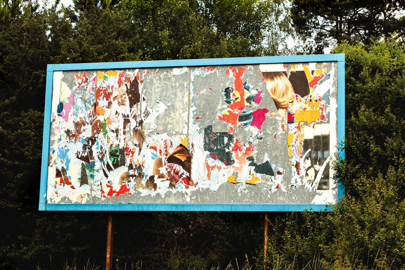 Download Billboard With Old Torn Posters Stock Image - Image of damaged, canvas: 25492005