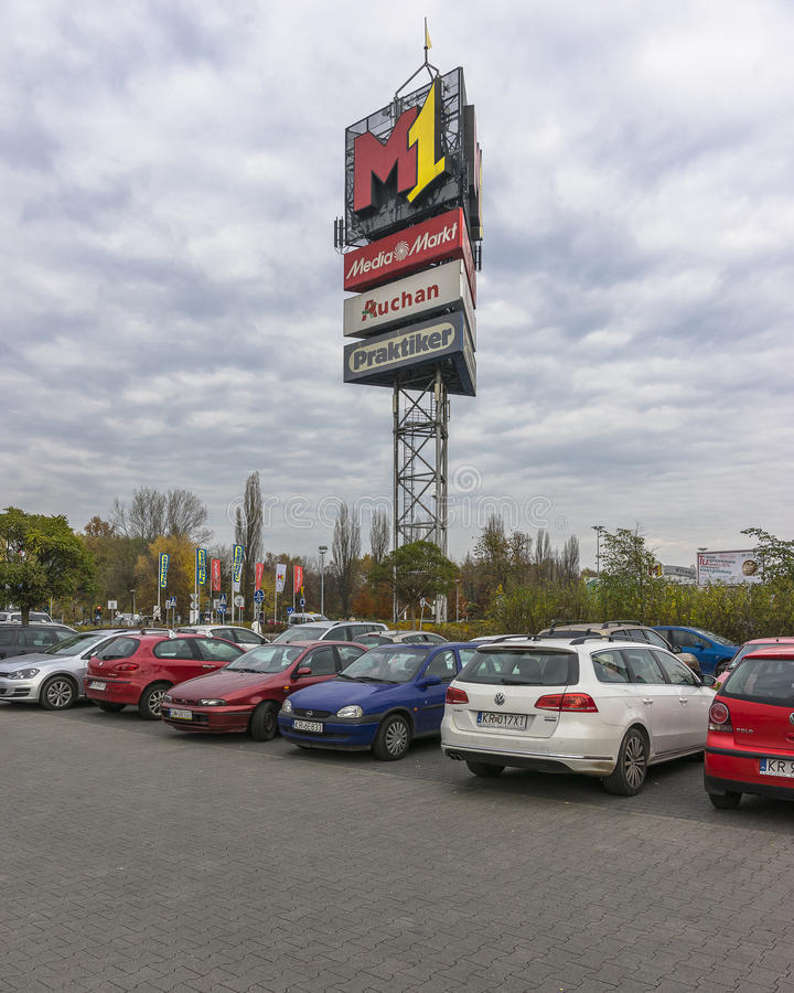Billboard shopping gallery. And cars on the parking lot in Krakow . Poland. Europe royalty free stock photos