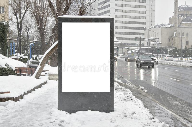 Billboard on street in winter royalty free stock photos