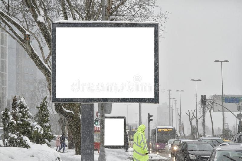 Billboard on street in winter royalty free stock images